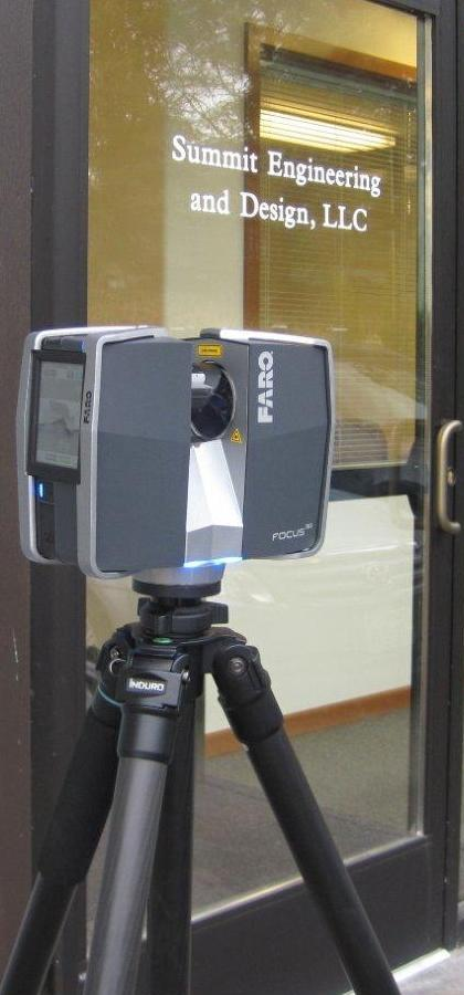 Image: Summit's FARO Focus3D scanner in front of the Summit office.